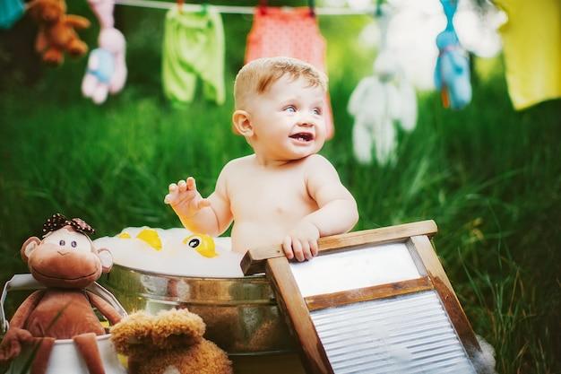 Little boy bathing in washbowl