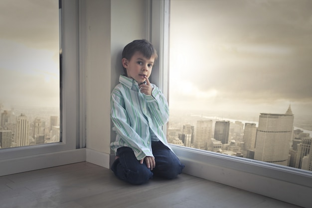 Little boy in a big city apartment