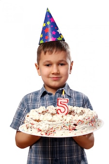 Little boy blowing a candle on his birthday