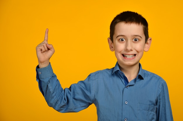 Little boy in blue shirt makes funny face
