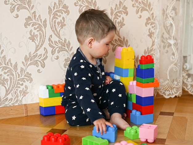 Little boy builds figures from the constructor