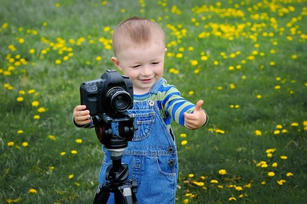 Little boy on the camera shoots