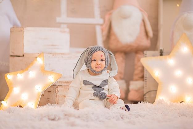 Little boy in christmas rabbit costume