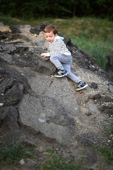 Little boy conquers the mountain.