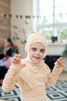 Little boy in costume of mummy celebrating halloween day