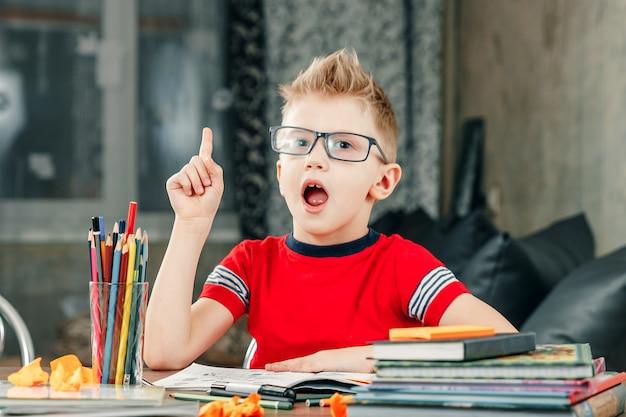 Little boy doing homework in school.