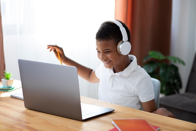 Little boy doing school online