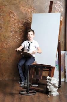 The little boy draws near easel