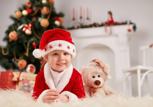 Little boy dressed as santa