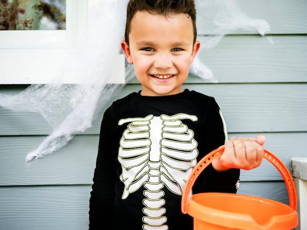 Little boy dressed up as a skelleton