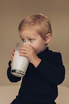 Little boy drinking milk