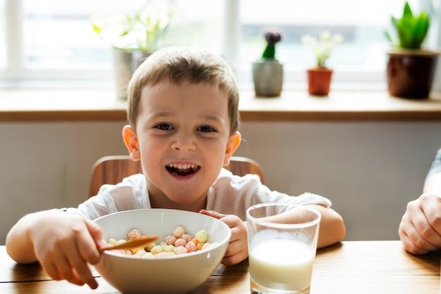 Little boy eating breakfast