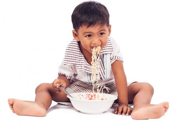 Little boy eating noodle