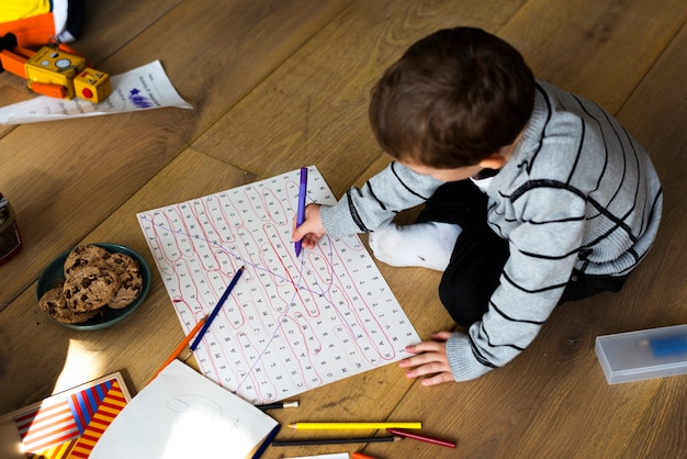 Little boy enjoying while drawing