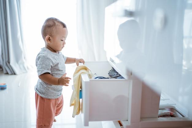 Little boy exploring his bedroom