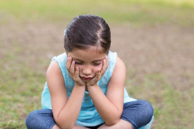 Little boy feeling sad in the park