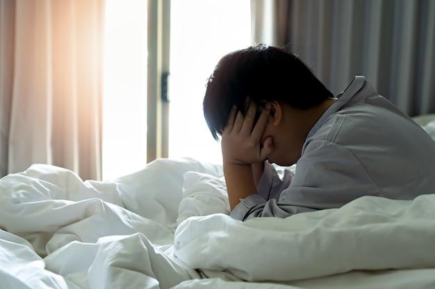 Little boy feels a headache in the morning