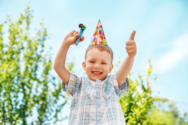 Little boy gesturing and having fun celebrating birthday. positive emotions.
