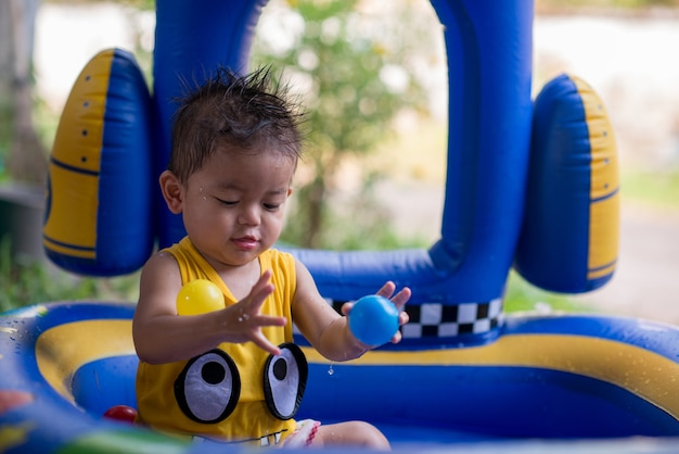 Little boy happy with kid pool