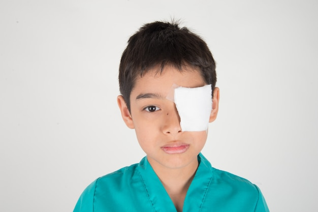 Little boy has eyes pain use bandage to cover