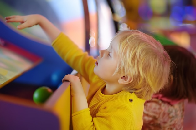 Little boy having fun in amusement in play center