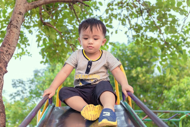 Little boy having fun on playground.