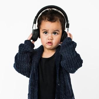 Little boy headphone listening music concept