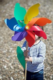 Little boy holding colored pinwheel