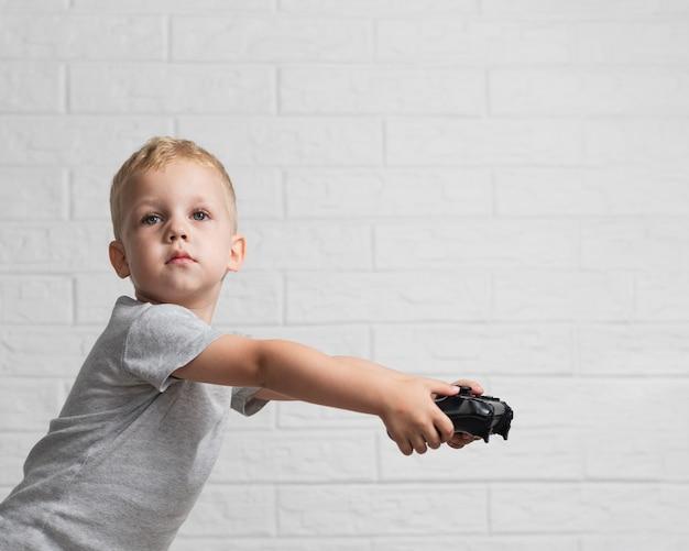 Little boy holding joystick at home