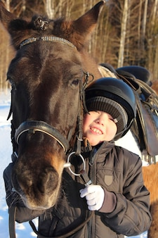 Little boy and horse.