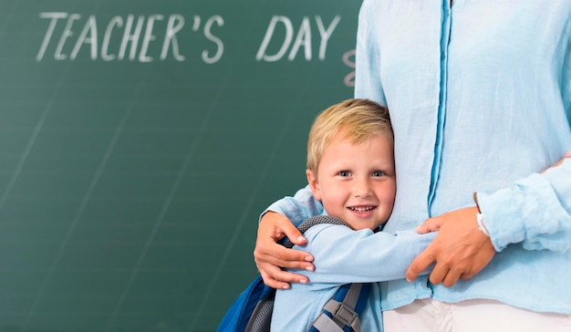 Little boy hugging his teacher