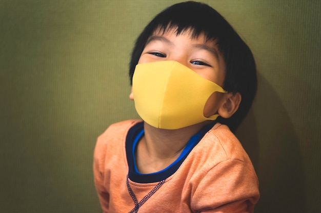 Little boy is wearing healthy mask protection from flu
