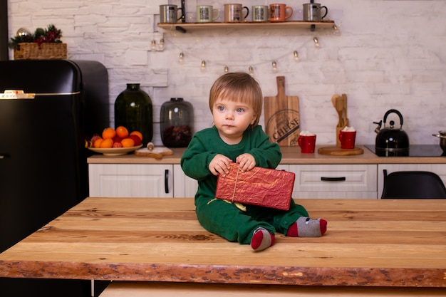 Little boy in kitchen at home. christmas morning