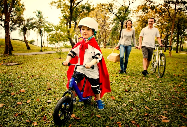 Little boy learning to bicycle