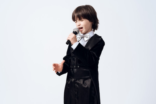 A little boy learns profession of a singer.