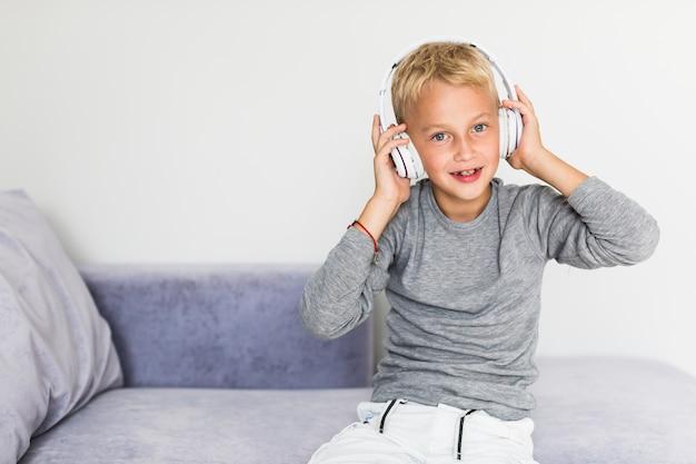 Little boy listening music at home