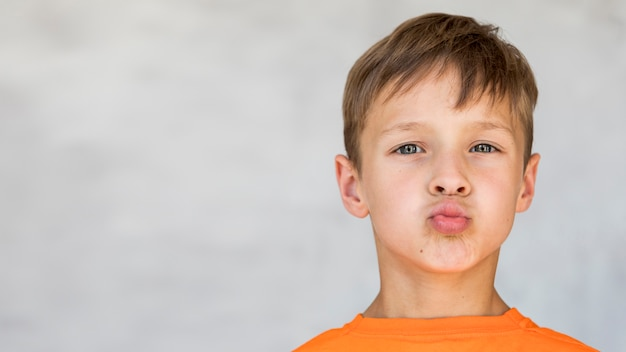 Little boy making a silly face with copy space