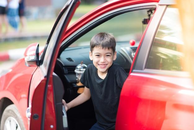 Little boy opening car's door