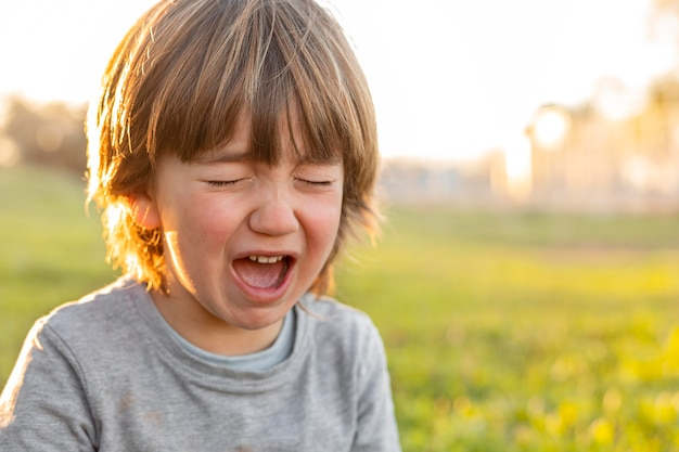 Little boy outdoor crying