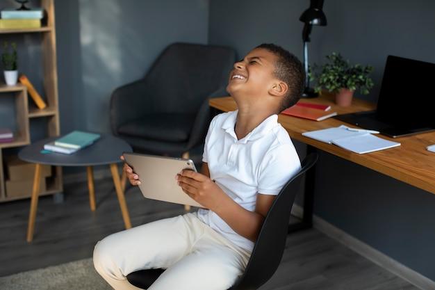 Little boy participating in an online class