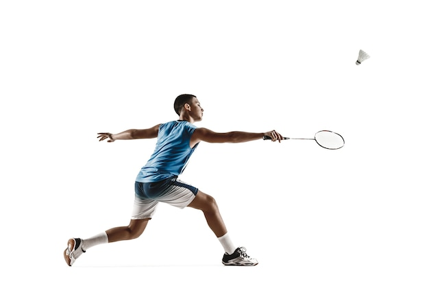 Little boy playing badminton isolated on white  background.