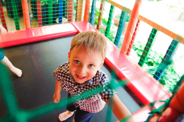 Little boy playing in the color maze.