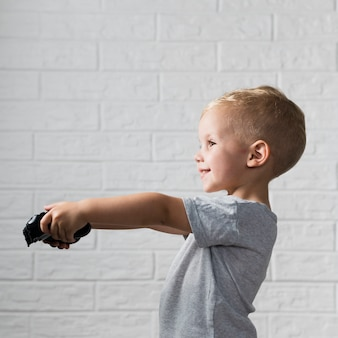 Little boy playing digital games with joystick