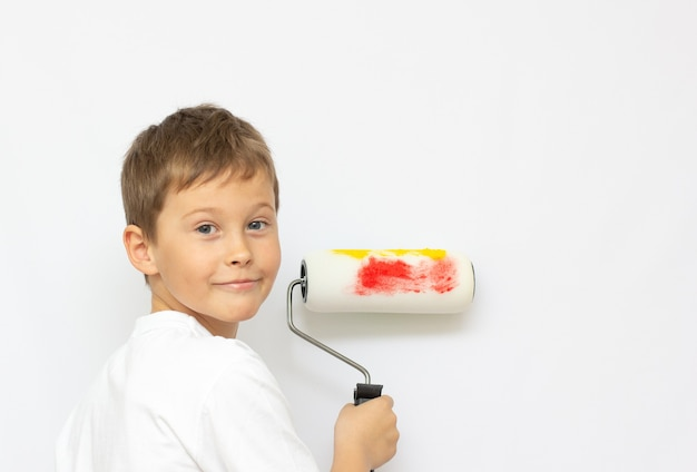 Little boy playing a painter. different occupations. isolated over white.
