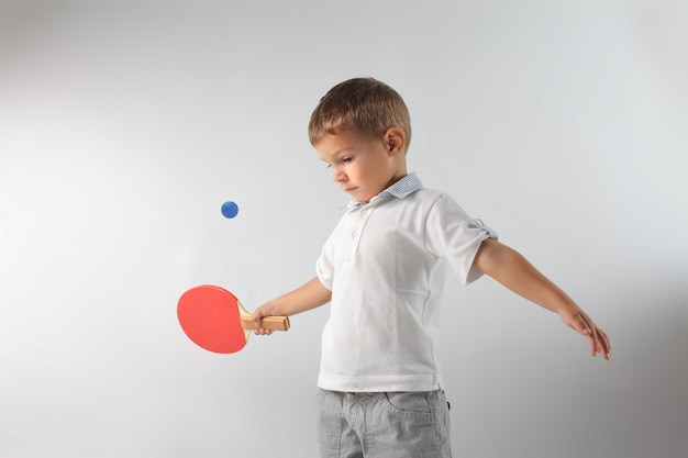 Little boy playing pingpong