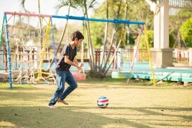 Little boy playing in the playground outdoor