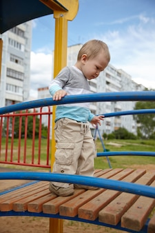 Little boy playing on a playground