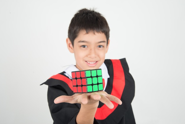 Little boy playing rubik cube