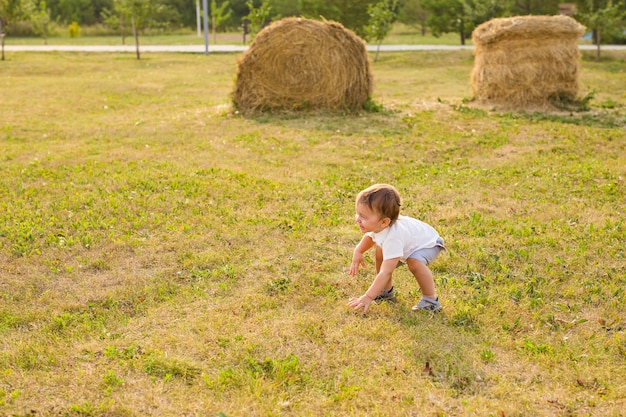 A little boy playing in summer nature