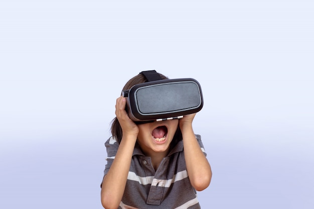 Little boy playing video games with vr.
